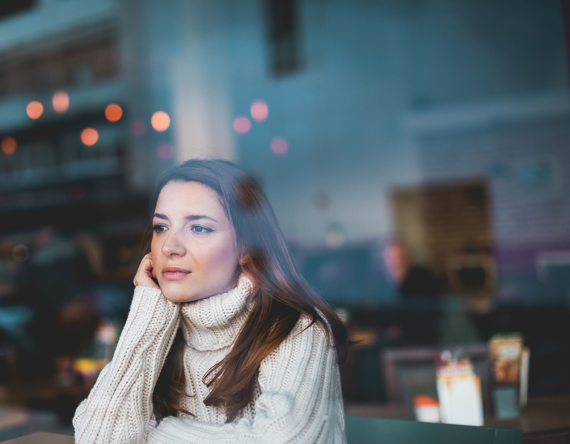 Lonely girl in cafe thinking about getting therapy for depression and anxiety. Find help with the best counselors in Katy, Texas | Cheri Locke depression therapist katy tx is ready to work with you.