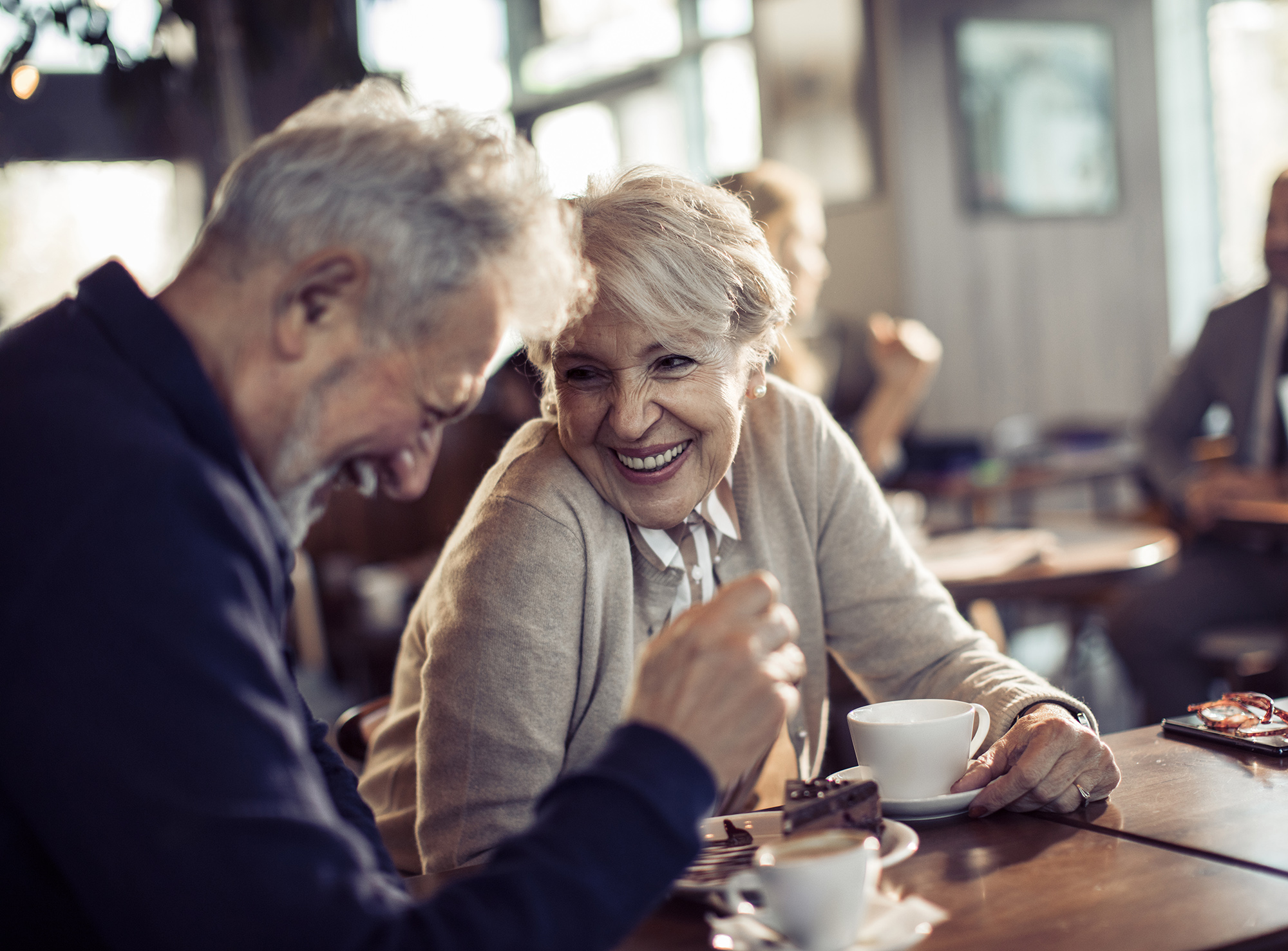 Close up of a happy senior couple having coffee in a cafe. Find a psychotherapist marriage counseling katy tx. Contact Cheri Locke today!