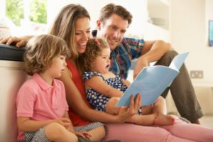 A family building a stronger relationship by sitting together and reading