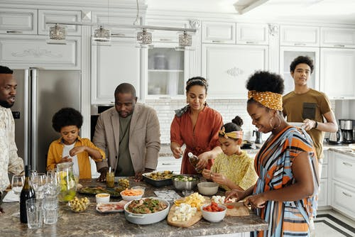 A big family hanging around in the kitchen talking and maintaining healthy relationships with one another. This family has been resolving their difference with family therapy in Katy, tx. There is no need to make therapy for families stressful. Locke Counseling and Consulting wants to help you find peace and connection. Call now!