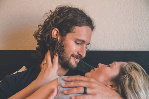 A man holding a woman and smiling. Represents the need for couples counseling to help keep a relationship exciting in Katy, TX 77494